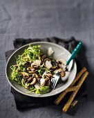 Marinated mushrooms with rocket and Parmesan cheese