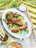 Tandoori salmon on a cucumber and mint salad