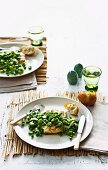 Crispy fish with peas and broad beans