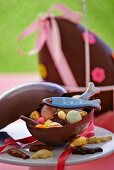 Various Easter sweets in a chocolate egg