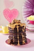 Brownie flapjacks with peanut butter sauce and salted pretzels