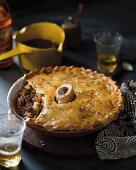 Boeuf Bourguignon pie with a bone
