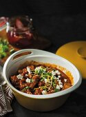 Braised beef with saffron, tomatoes and peppers