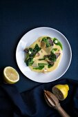 Marinated mushrooms with broccoli, lemon dressing, cheese and spinach chips