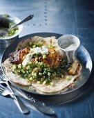 Tandoori yellow-tailed mackerel with a kumato and cucumber salsa on unleavened bread