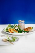 Grilled clementines served with bean salad with goat's cheese and walnut sauce
