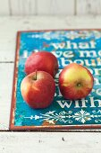 Three Gloster apples