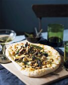 Pizza with mushrooms and sage