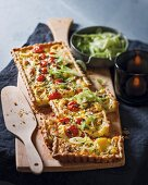Camembert tart with tomatoes and fennel
