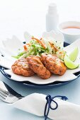 Fish cakes with lettuce and limes (Thailand)
