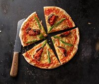 Pizza Margherita with asparagus and aubergines on a baking tray