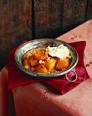 Pumpkin in syrup with cardamom and clotted cream
