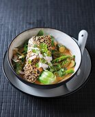 Fish with a sesame seed crust with red Thai vegetable curry