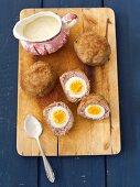 Scotch eggs with a horseradish sauce