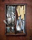 Antique cutlery in a cutlery drawer