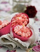 Pink cupcakes decorated with gold pearls