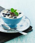 Yoghurt with buttermilk, honey, grilled country bread with maple syrup, blueberries and lemon balm