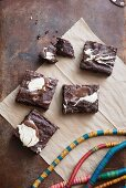 Chocolate and nut brownies decorated with melted chocolate