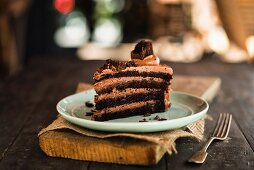 Mousse au chocolat cake on a rustic board