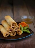 Deep fried spring rolls with edamame beans and carrots