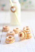 Mini Bundt cakes on a white wooden table