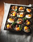 Breakfast canapés with sausage and egg