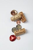 A symbolic image of a gourmet investment: wine bottle corks and money