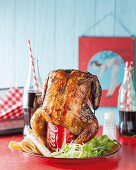 Roast chicken on a cola can