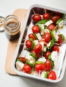 Tomato and mozzarella skewers with basil and balsamic vinaigrette