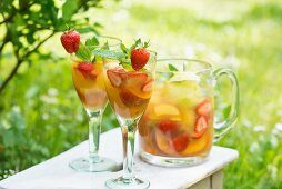 Summer drinks made with fresh fruit and berries