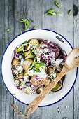 Rustic potato salad with red onions, spring onions and herb quark