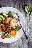 Sweet potato salad with avocado and baby spinach