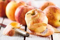 Royal Gala apples, one peeled