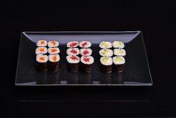 A sushi platter with various nori maki