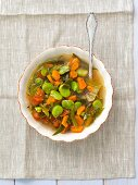 Minestrone with cabbage, tomatoes, carrots and broad beans