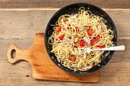 Spaghetti with smoked mackerel, cherry tomatoes and olives