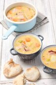 Yellow pea soup with smoked bacon and tarte flambée