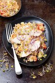 A salad with lentils, cucumber, tomato, radish and and grilled chicken breast