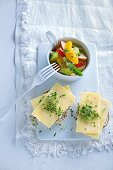 Herb rolls with cheese and fruit salad