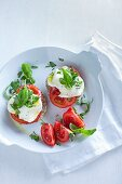 Herb bread rolls topped with mozzarella and tomatoes