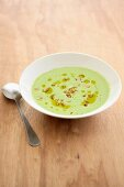 Cold yoghurt and herb soup with olive oil and nuts
