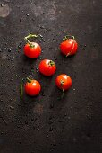 Five freshly washed cherry tomatoes