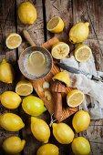 Freshly picked lemons for making lemon juice on a wooden table