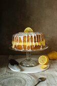 Sponge cake with lemon curd and lemon icing on a cake stand