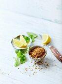 Brown sugar, lemon wedges and mint leaves