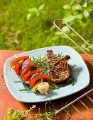 Grilled chops with vegetable skewers