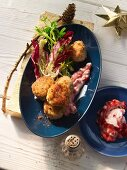 Codfish balls with a mixed leaf salad and lingonberries (Sweden)
