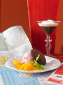 Cranberry parfait with oranges, chocolate cookies and an espresso martini