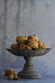 Spelt scones with raisins and cranberries in a grey bowl