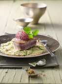 Tuna fish fillet with veal tatar on a potato and courgette gratin